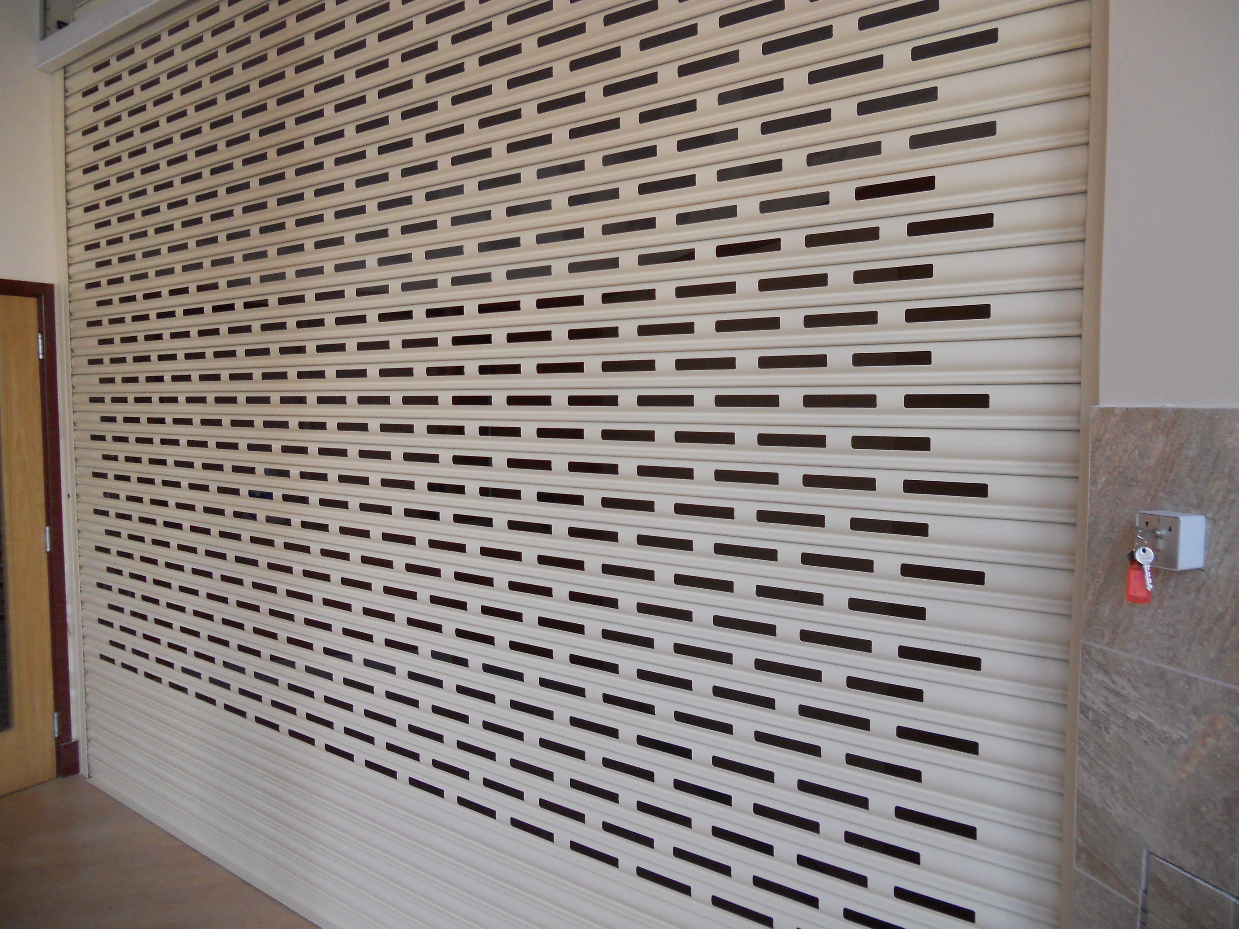 Punched and Glazed Roller Shutters